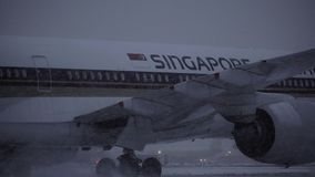 Singapore Airlines plane, view in snowfall at Domodedovo Airport, Moscow