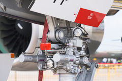 Singapore Airshow 2016. Singapore - February 16, 2016: Detail of the nose landing gear of an Airbus A380 at Singapore Airshow at Changi Exhibition Centre in Royalty Free Stock Image