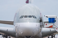 Singapore Airshow 2016. Singapore - February 17, 2016: Front of an Airbus A380 in the livery of Qatar Airways during Singapore Airshow at Changi Exhibition Royalty Free Stock Photos