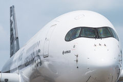 Singapore Airshow 2016. Singapore - February 17, 2016: Front of an Airbus A350 XWB in Airbus factory livery during Singapore Airshow at Changi Exhibition Centre Royalty Free Stock Image