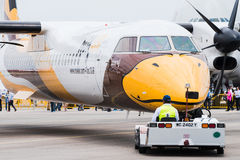 Singapore Airshow 2016. Singapore - February 17, 2016: Front of a Bombardier Q400 NextGen in Nok Air livery being pushed into position during Singapore Airshow Royalty Free Stock Image
