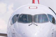 Singapore Airshow 2016. Singapore - February 16, 2016: Front detail of a Bombardier CS100 medium range airliner in Swiss livery during Singapore Airshow at Royalty Free Stock Image