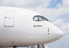 Singapore Airshow 2016. Singapore - February 17, 2016: Front section of an Airbus A350 XWB in Airbus factory livery during Singapore Airshow at Changi Exhibition Stock Images