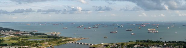 Singapore anchorage area panorama opposite Gardens by the Bay with many ships on an anchorage.  royalty free stock images