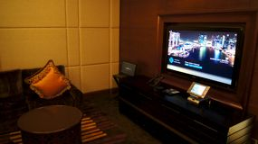 SINGAPORE - APR 2nd 2015: In-Home Theater in Luxury Hotel Room royalty free stock images