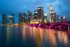 SINGAPORE - APRIL 23: The Singapore skyline shines at night. Si Stock Photography