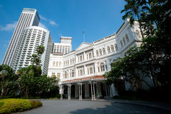 SINGAPORE - APRIL 23: The Raffles Hotel opened in 1899, and is n Stock Photos