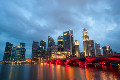 SINGAPORE - APRIL 23: The Singapore skyline shines at night. Si Royalty Free Stock Image