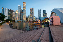 SINGAPORE - APRIL 25: The Singapore skyline shines at night as Stock Photos