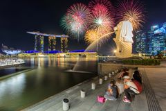 SINGAPORE - APRIL 21, 2017: Beautiful firework over central business district building of Singapore city at night Royalty Free Stock Photography