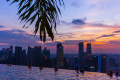 SINGAPORE - APRIL 14: Pool on roof and Singapore city skyline on Stock Images