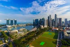 SINGAPORE - APRIL 15: Singapore city skyline and Marina Bay on A Royalty Free Stock Photo