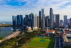 SINGAPORE - APRIL 15: Singapore city skyline and Marina Bay on A Stock Photo