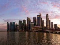 SINGAPORE - APRIL 15: Singapore city skyline and Marina Bay on A Stock Photos