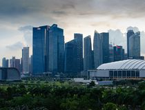Singapore - April 28, 2014: Skyscrapers of an Asian city at sunset royalty free stock photography