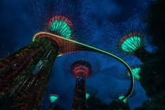 Singapore - APRIL 30, 2018: The sound and light show of Supertree Grove in the Garden by the Bay at night, Singapore. stock photography
