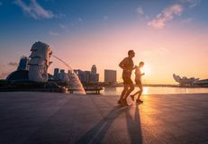 SINGAPORE - APRIL 30, 2018: Unidentified people runnig in Merlio. N Park and Singapore city skyline at sunrise on April 30, 2018 Stock Photo