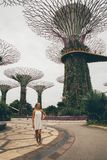 Girl Exploring Gardens by the Bay in Singapore. SINGAPORE ASIA - MAY 9: Beautiful girl exploring Gardens by the Bay with an amazing view on the Supertree Grove royalty free illustration