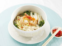 Singapore asian style prawn noodle. Singapore asian style friend egg noodle, traditional cuisine in singapore and malaysia kang kong vegetables with fish cake royalty free stock photos