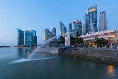 Singapore city skyling in business district at dusk. stock photos