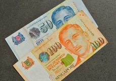 Singapore banknote dollar SGD. Singapore banknotes 50-100 SGD - currency concept - close up Royalty Free Stock Photo