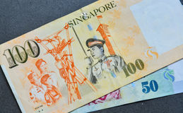Singapore banknote dollar SGD. Close-up of Singapore banknotes 50-100 SGD. Singapore is a gateway to Southeast Asia and is a wealth management hub Royalty Free Stock Photos