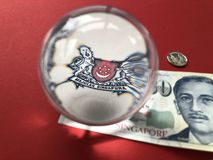 Singapore $50 banknotes and a crystal ball royalty free stock photography