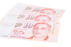 Singapore banknotes dollars 10 SGD isolated on white backgroun. Singapore banknotes dollars 10 SGD isolated on a white background Stock Photo