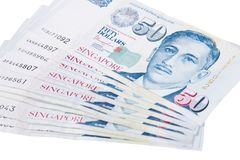 Singapore banknotes dollars 50 SGD isolated on white backgroun. Singapore banknotes dollars 50 SGD isolated on a white background Royalty Free Stock Photography