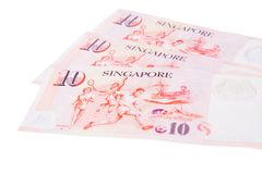 Singapore banknotes dollars 10 SGD isolated on white backgroun. Singapore banknotes dollars 10 SGD isolated on a white background Royalty Free Stock Photo