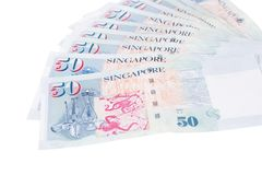 Singapore banknotes dollars 50 SGD isolated on white backgroun. Singapore banknotes dollars 50 SGD isolated on a white background Stock Photo