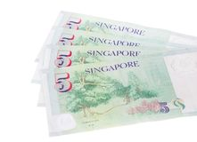Singapore banknotes dollars 5 SGD isolated on white background. Singapore banknotes dollars 5 SGD isolated on a white background Stock Photo