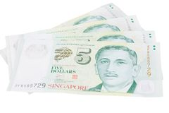 Singapore banknotes dollars 5 SGD isolated on white background. Singapore banknotes dollars 5 SGD isolated on a white background Royalty Free Stock Photos