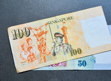 Singapore banknote dollar SGD. Singapore banknotes 50-100 SGD on the granite floor - currency concept - close up Stock Images