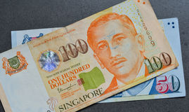 Singapore banknote dollar SGD. Singapore banknotes 50-100 SGD. Singapore has a highly developed and successful free-market economy Stock Photo