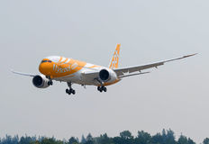 Singapore based Scoot Airlines Boeing 787-8 dreamliner`s side shot. Singapore based Scoot Airlines Boeing 787-8 dreamliner approaching for landing on the runway Royalty Free Stock Images