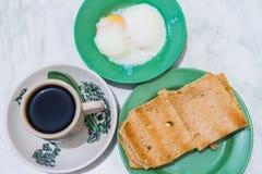 Singapore Breakfast Kaya Toast, Coffee bread and Half-boiled egg Royalty Free Stock Photo