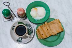 Singapore Breakfast Kaya Toast, Coffee bread and Half-boiled egg Stock Photography