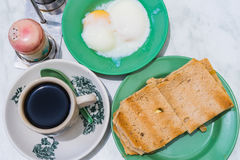 Singapore Breakfast Kaya Toast, Coffee bread and Half-boiled egg Stock Image