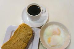 Singapore Breakfast Kaya Toast, Coffee bread and Half boiled egg Royalty Free Stock Image