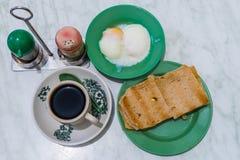 Singapore Breakfast Kaya Toast, Coffee bread and Half-boiled egg Royalty Free Stock Image
