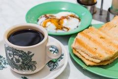 Singapore Breakfast Kaya Toast, Coffee bread and Half-boiled egg. Singapore Breakfast called Kaya Toast, Coffee bread and Half-boiled eggs, Chinese coffee in Royalty Free Stock Image
