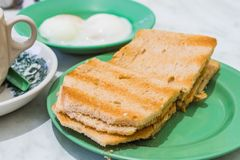 Singapore Breakfast Kaya Toast, Coffee bread and Half-boiled egg. Traditional Singapore Breakfast called Kaya Toast, Bread with Coconut Jam and Half-boiled eggs Royalty Free Stock Photography