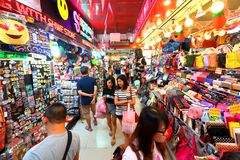 Singapore: Bugis street market. Locals and tourist shopping in the lane within the Bugis street market . This market have many stalls selling a vast array of stock photography