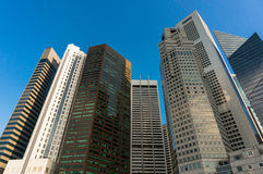 Singapore business centre. Bottom view of Singapore downtown skyscrapers - modern skyscrapers, business buildings against sky on the background. Space for text Stock Photography