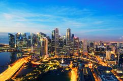 Singapore business district and city at twilight in Singapore Royalty Free Stock Image