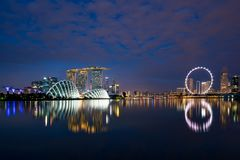 Singapore business district skyline in night at Marina Bay, Sing Stock Photos