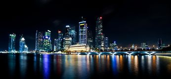 Singapore CBD at night. Singapore at night, the lights of the city reflect on the water Royalty Free Stock Photos