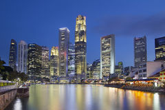 Singapore Skyline by Boat Quay. Singapore Central Business District (CBD) City Skyline by Boat Quay Along Singapore River at Blue Hour Royalty Free Stock Images