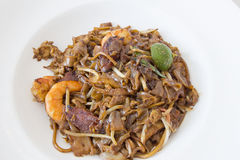 Singapore Char Kway Teow. Rice Noodle Stir Fry with Prawns Chinese Sausage and Fishcake stock photos
